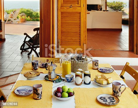 Coloured Set Table For Breakfast Time In A Seaside House Stock Photo & More Pictures of Balcony