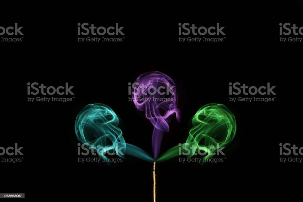 coloured smoke coming out of incense sticks. Abstract smoke art stock photo