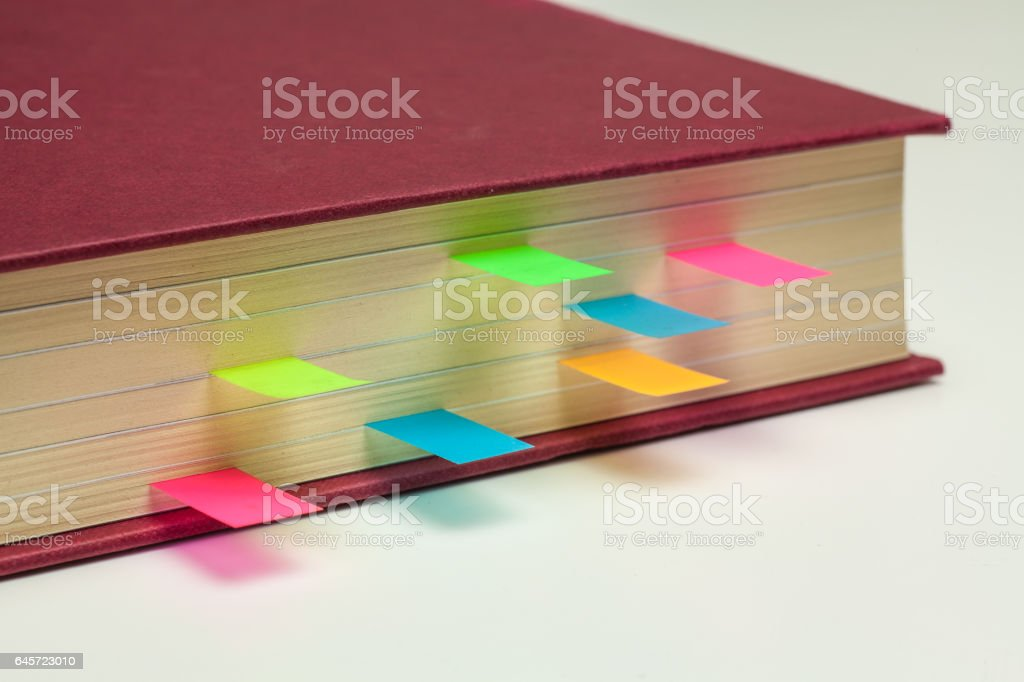 Coloured Sticky Page Markers in a text book stock photo