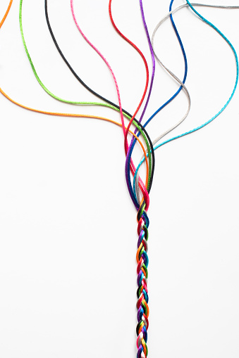 171053447 istock photo Coloured String Woven Together To Illustrate Concepts Of Unity Society Togetherness and Cooperation 1251302011