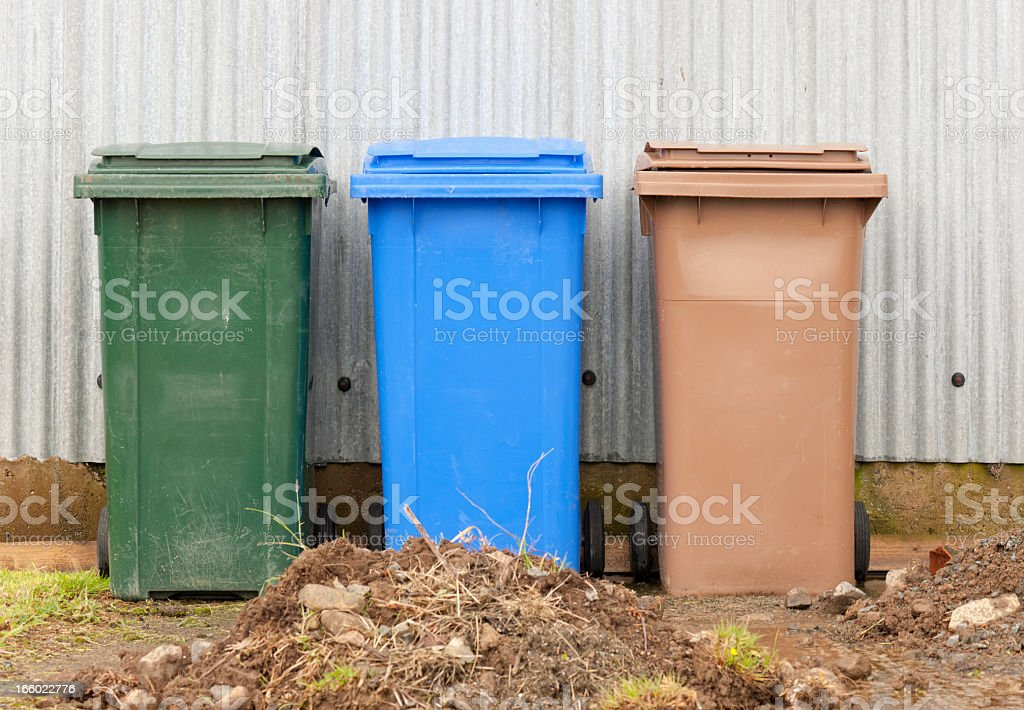 Coloured Wheelie Bins for Recycling and Waste stock photo