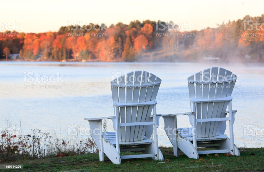 Adirondack Chairs On A Wooden Dock Stock Photo - Download