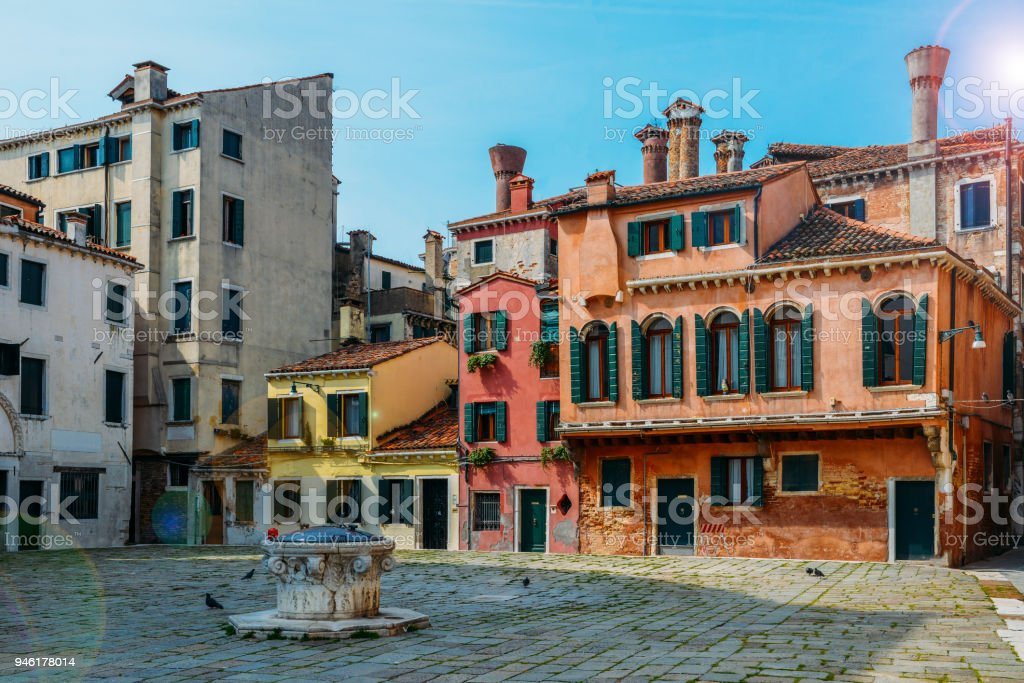 Colourful and historic houses at the Campo della Maddalena in Venice, Italy, with a variety of shapes and sizes in the local architecturural style. stock photo