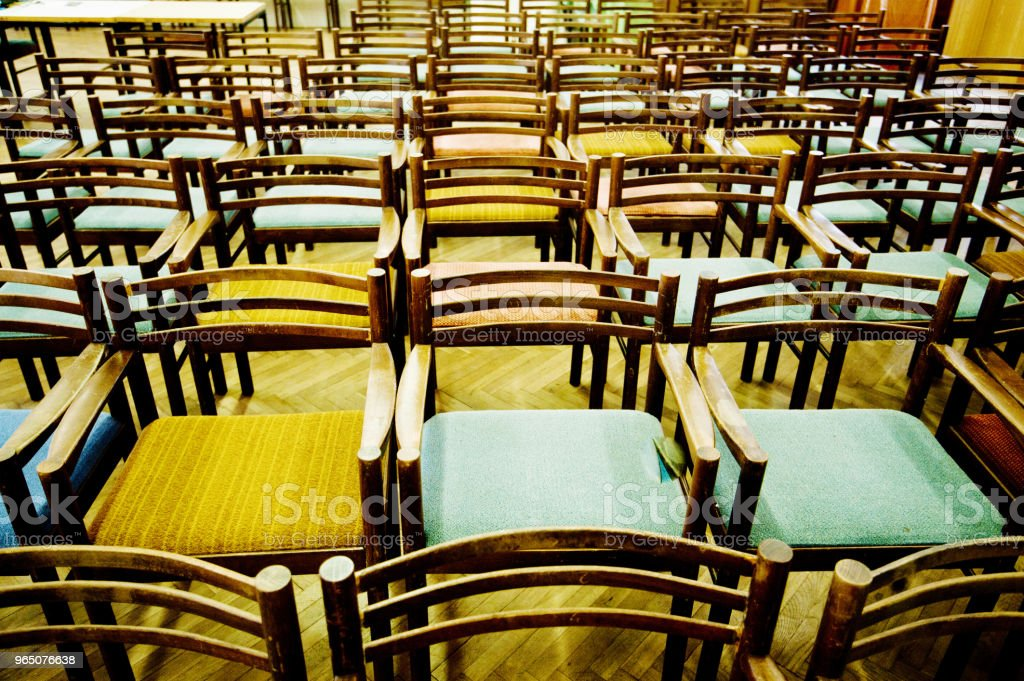 Colourful Arranged Wooden Seats royalty-free stock photo