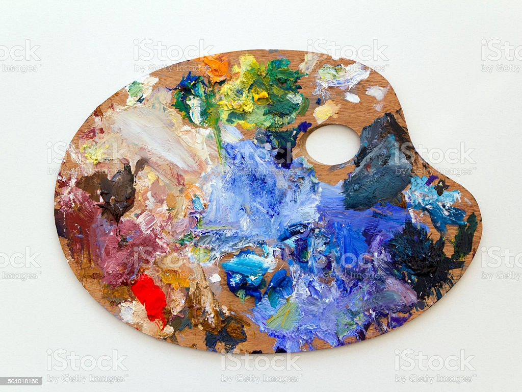 Colourful artists oil paint palette on white stock photo