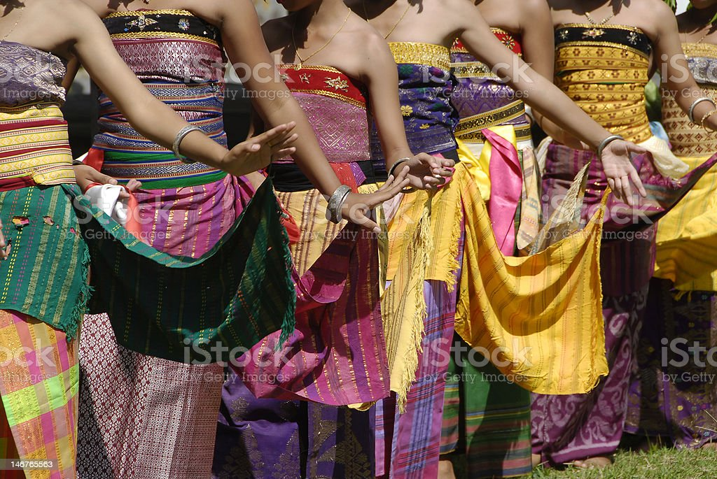 Colourful Balinese Rejang dancers in traditional village ceremony stock photo