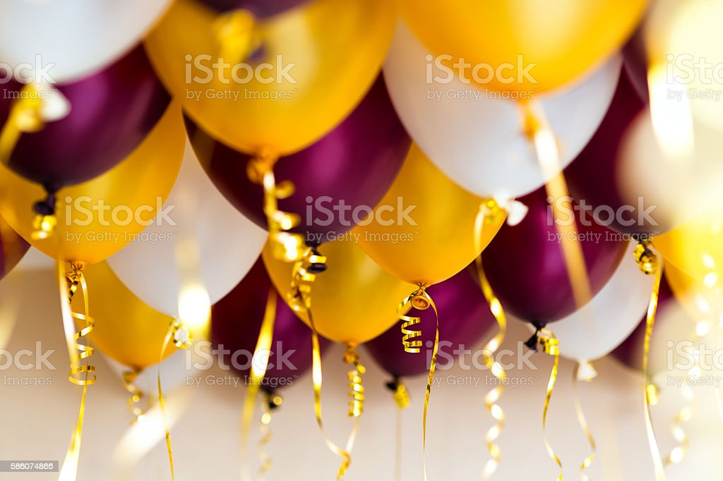 colourful balloons, golden, white, red, streamers isolated stock photo