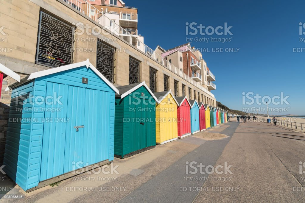 Colourful beach huts on Boscombe seafront in Bournemouth stock photo