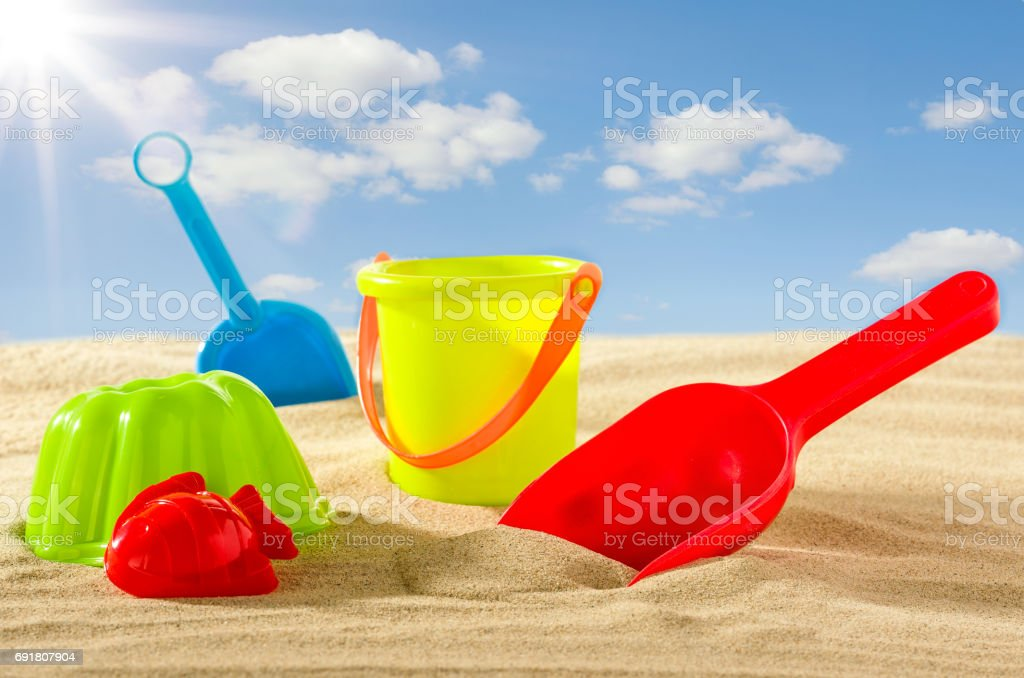 Colourful beach toys for kids in the sand stock photo
