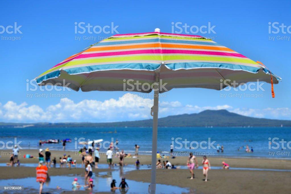 Colourful beach umbrella on a summer sunny day stock photo