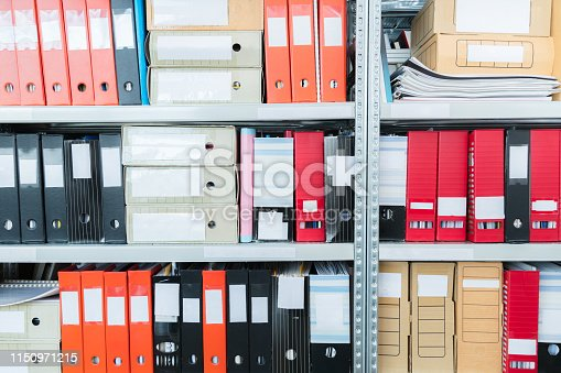 502086873 istock photo Colourful blank blind folders with files in the shelf. Archival, stacks of documents at the office or library. Physical document storage units 1150971215