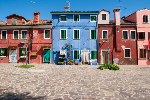 Colourful blue and red house walls in Burano, Venice, Italy - foto stock