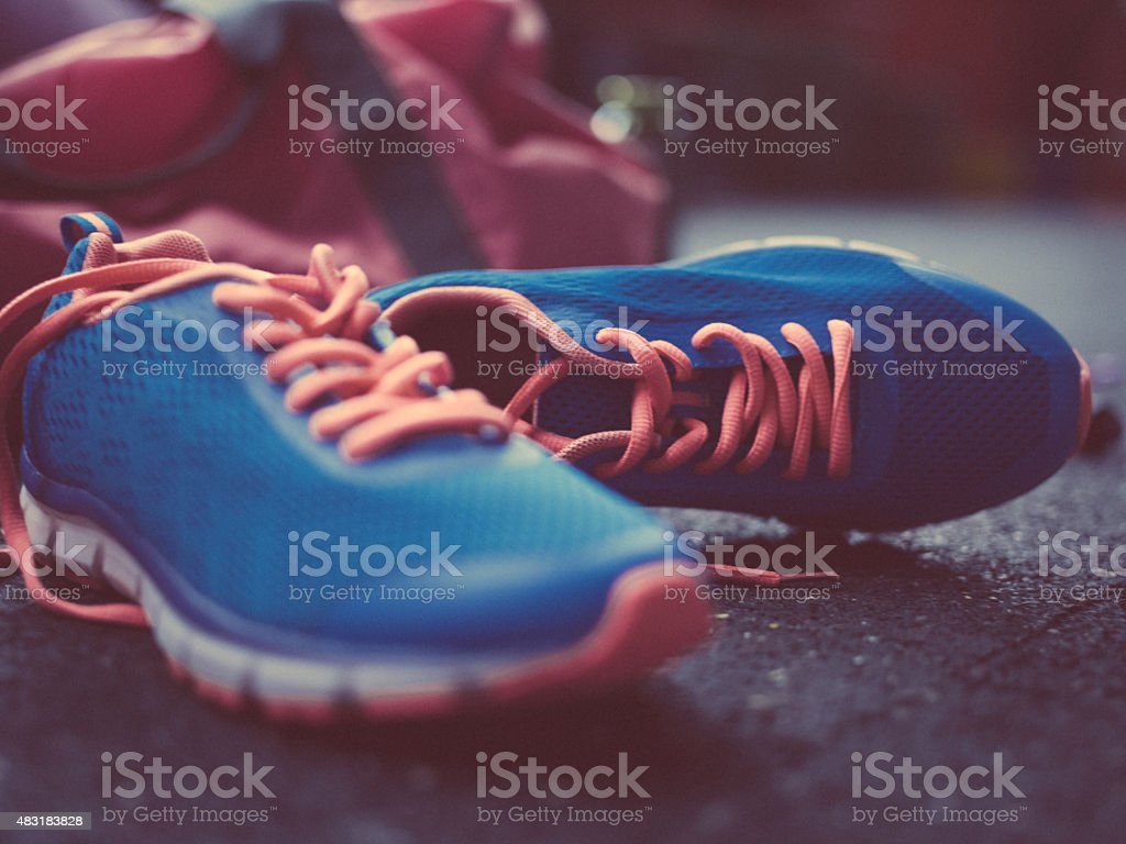 Colourful blue sneakers on a concrete floor in a gym stock photo