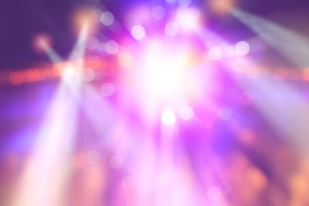 colourful blurred lights on stage, abstract image of concert lighting - nightclub stock photos and pictures