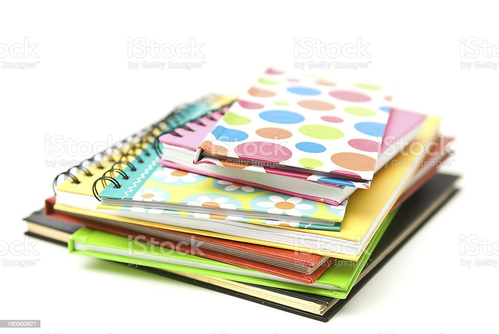 Colourful books stacked on a white background. royalty-free stock photo