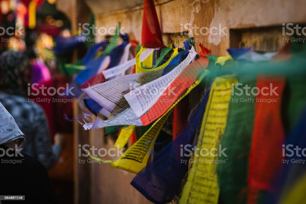 Colourful Buddhist prayer flags flapping in the wind stock photo