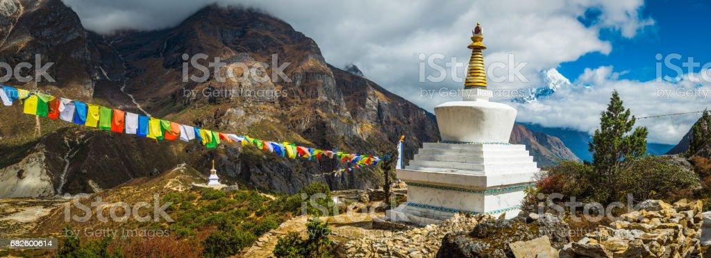 Colourful Buddhist prayer flags white stupa Sherpa village Himalayas Nepal stock photo