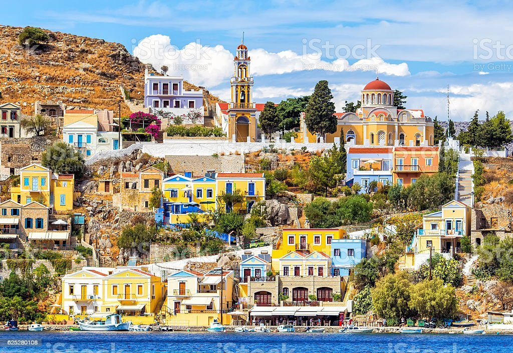Colourful buildings and Church on beautiful summers day at Symi stock photo