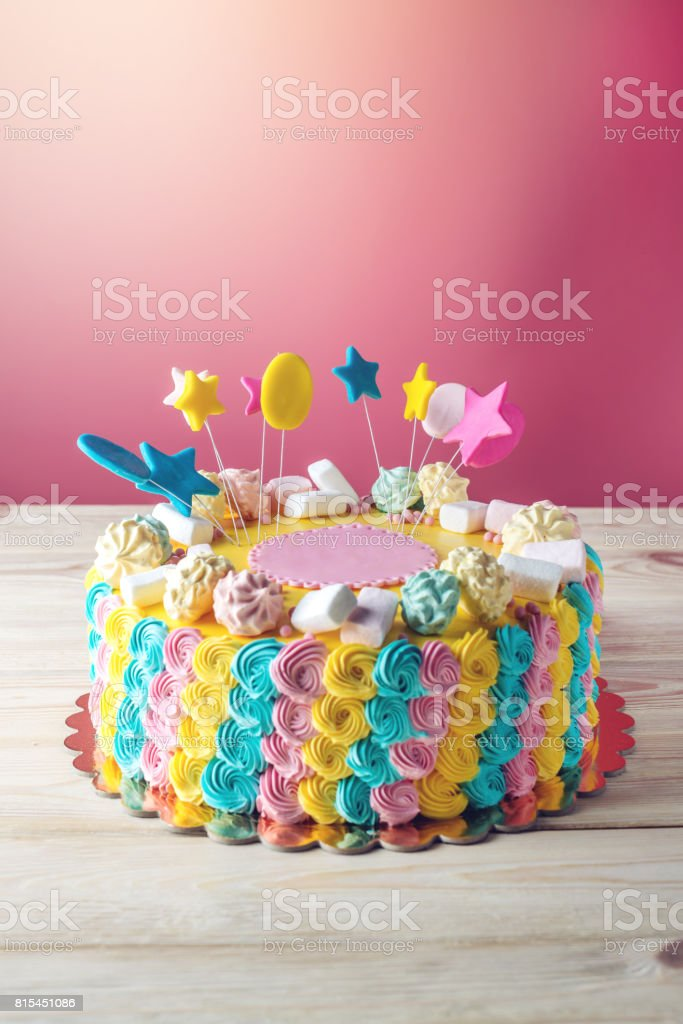 Colourful children's cake decorated with marshmallows and meringues stock photo