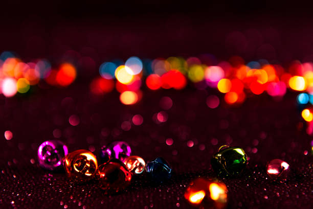 Colourful Christmas jingle bells. Red filter. Blurred bokeh background. stock photo
