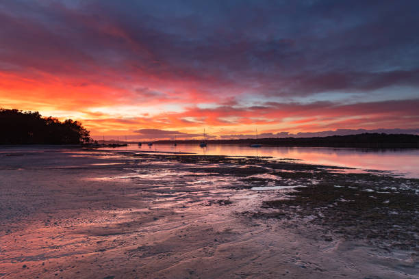 Colourful Cloudy River Sunrise Waterscape stock photo