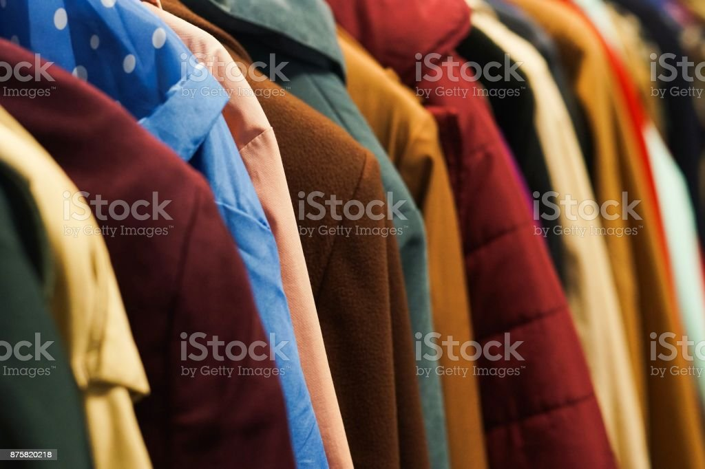 Colourful coats in the charity shop. royalty-free stock photo