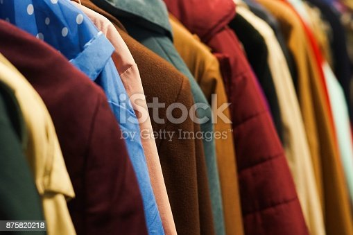 Rack with colourful coats. Charity second hand clothes.