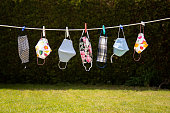 istock Colourful corona masks in the garden hung up on a leash 1222645473