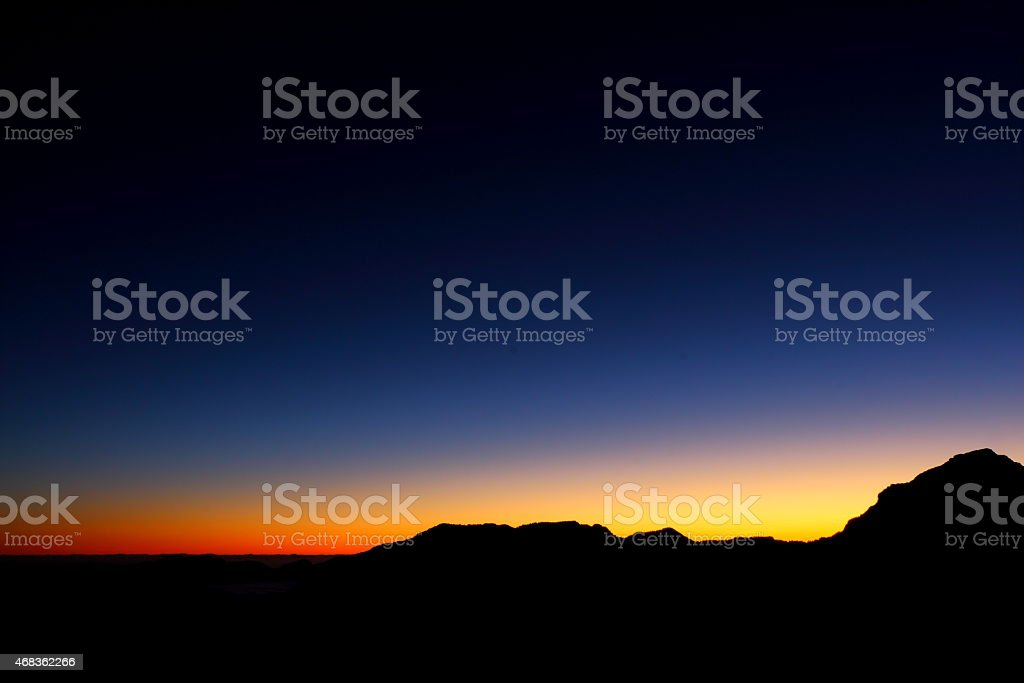 Colourful dawn skies with mountain range royalty-free stock photo