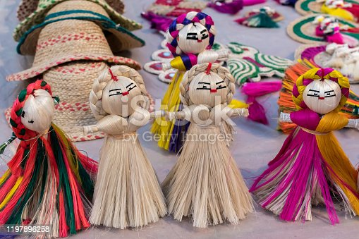 Colourful decorative wall hangings, dolls made of jute, handicrafts for sale (Selective Focus)