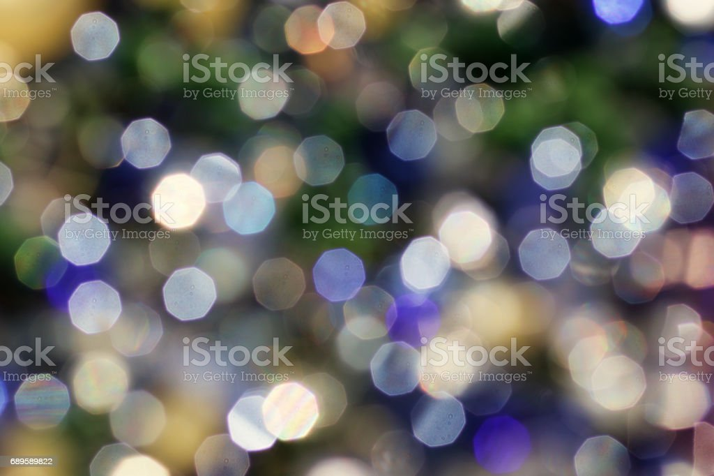 Colourful defocused bokeh background lens flare octagons stock photo