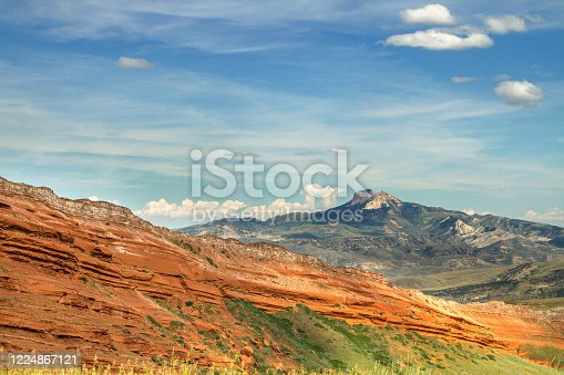 Unusual mountain peak and red seamed rock views near Shoshone National Forest