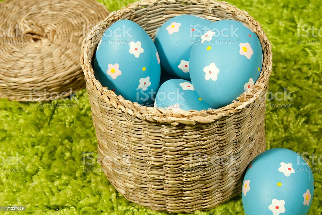 Colourful easter eggs in basket stock photo