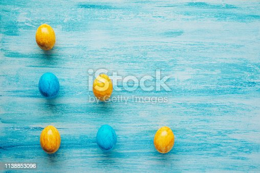 Colourful Easter eggs  on a blue background