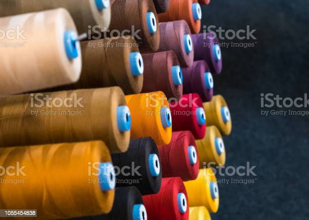 Colourful embroidery thread spool using in garment industry row of picture id1055454838?b=1&k=6&m=1055454838&s=612x612&h=4sfauai6k rclkszab3cn4bpp6xapxe1fb8knfntry8=
