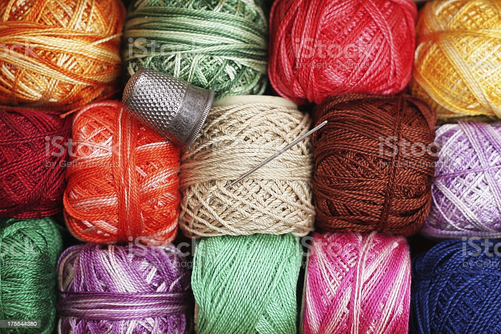 Colourful embroidery threads, needle and thimble royalty-free stock photo