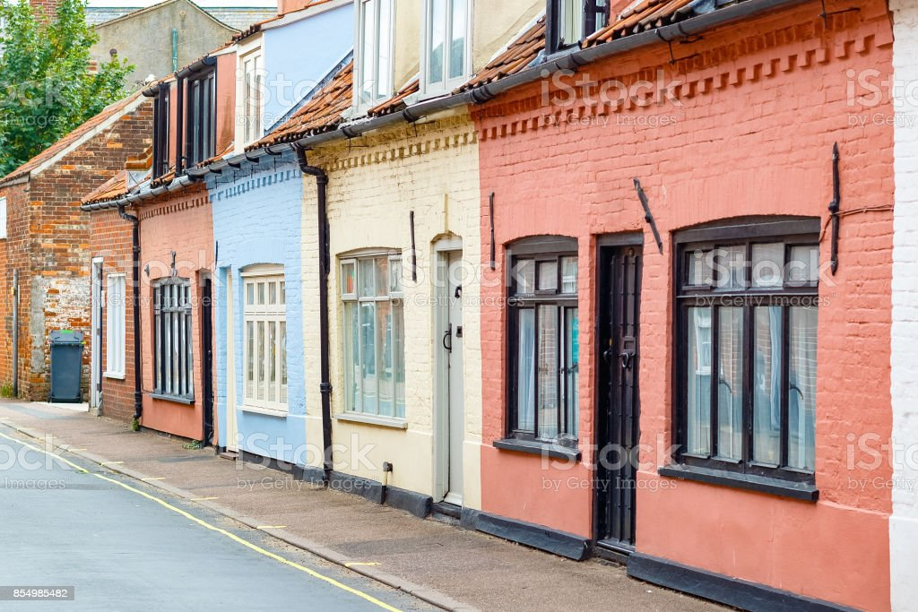 Colourful English brick cottages in the popular seaside town Southwold of the UK stock photo