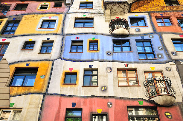 colourful facade of the hundertwasser house, hundertwasserhaus, vienna, austria - vienna stock photos and pictures