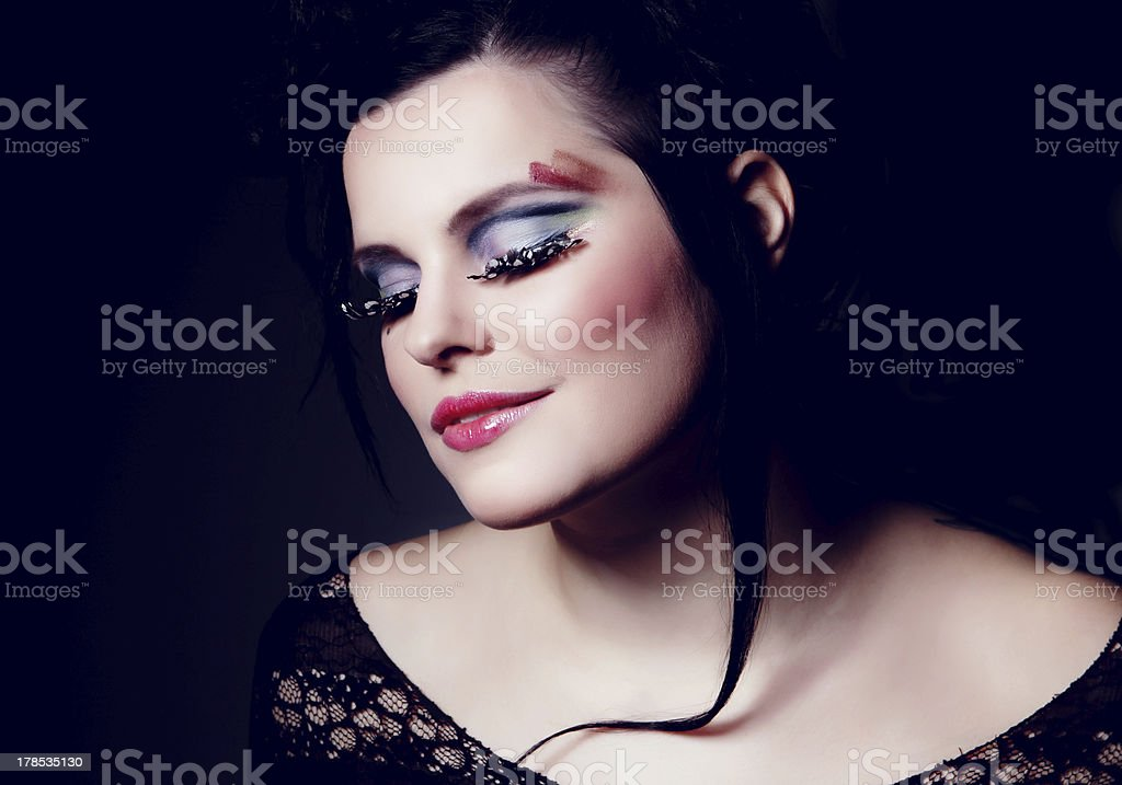Colourful face in darkness royalty-free stock photo