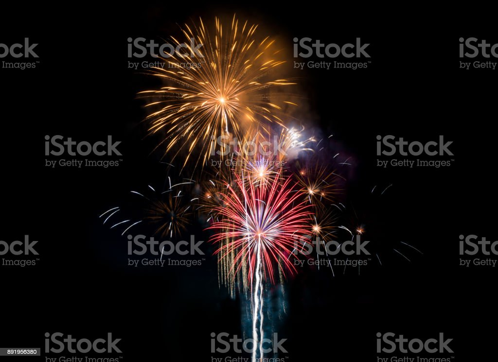 Colourful Fireworks at night over dark sky stock photo