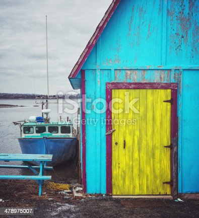 A colourful fishing village shack and boat on Nova Scotia's Eastern Shore.