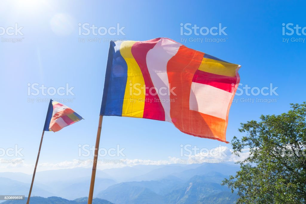 colourful flags waving in strong wind - sikkim, India stock photo