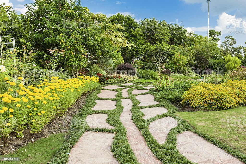 Colourful Flowerbeds and Winding Grass Pathway in an Attractive royalty-free stock photo