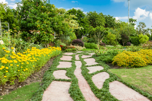 Colourful Flowerbeds and Winding Grass Pathway in an Attractive