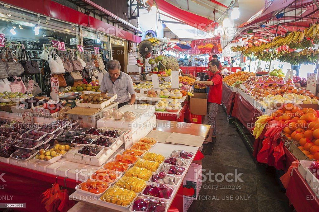 Colourful fresh fruit market stall under awnings in Singapore stock photo