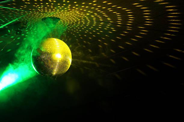 Colourful glitter mirrorball in disco new stock photo