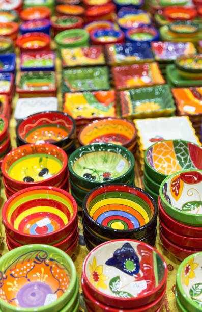 Colourful hand painted bowls and pots for sale stock photo