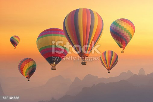 530709531 istock photo Colourful hot-air balloons flying over the mountain and traveler 542104566