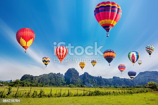 istock Colourful hot-air balloons flying over the mountain. 584216764