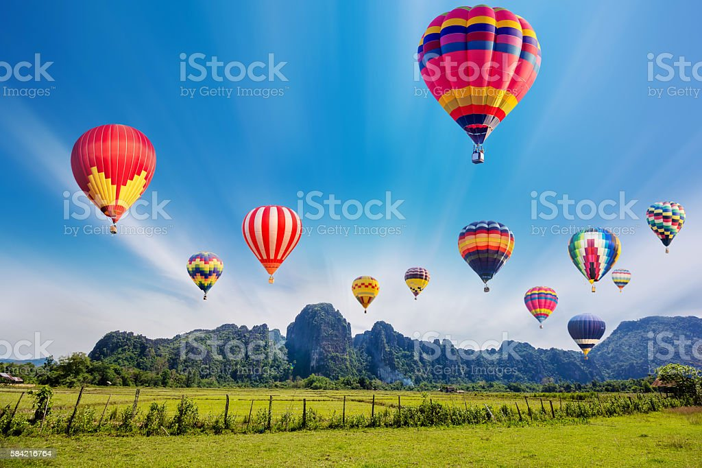 Colourful hot-air balloons flying over the mountain. ストックフォト